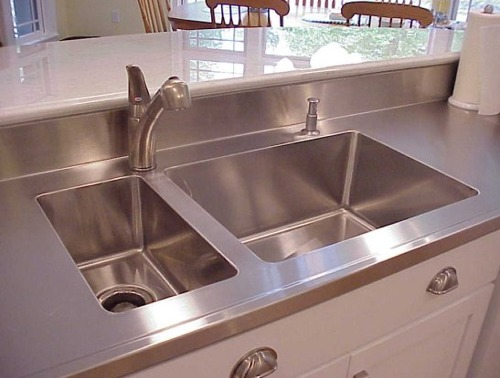 Stainless steel countertops casual cottage for Stainless steel countertop with integral sink